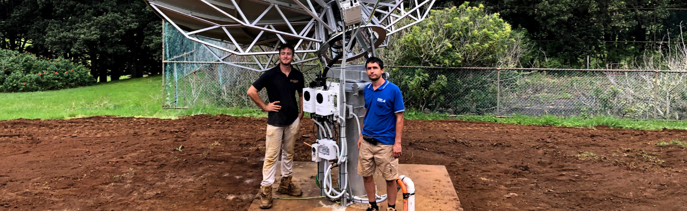 Evan Kirk and Mukhtar T installing a 4,5m satellite dish in Norfolk Island