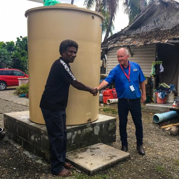 Garry Cratt shaking the Fishing Village Chief's hand in Honiara, Solomon Islandsa